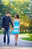 Pretty couple in love on the bridge in the park  — Stock Photo