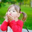 Little girl sends an air kiss — Stock Photo #53930395