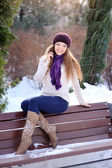 Attractive young woman in wintertime outdoor — Stock Photo