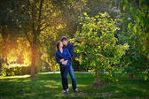 Romantic teenage couple embracing outdoors  — Stock Photo