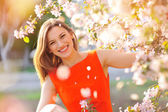 Young beautiful woman in blooming garden  — Stock Photo
