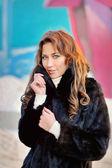 Girl in a black winter coat  — Stock Photo