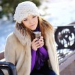 Winter girl drinking warm beverage. — Stock Photo #54917145