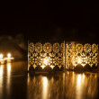 Two candlesticks on a dark background — Stock Photo #54917223