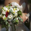 Wedding bouquet of tender tones in the hands of the newlyweds — Zdjęcie stockowe #55075667