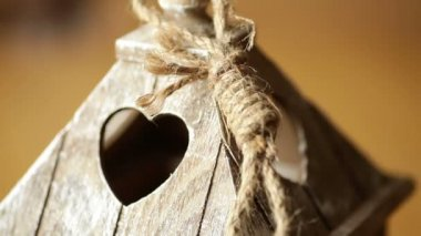 Elements wooden candlestick close-up with a window in the form of heart — 图库视频影像