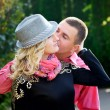 Young couple outdoor portrait. Beautiful pretty girl kissing han — Stock Photo #55264137