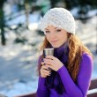 Winter girl drinking warm beverage — Stock Photo #55618841