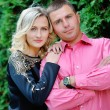 Happy young attractive couple portrait, smiling in outdoor envir — Stock Photo #55618887