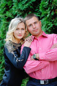 Happy young attractive couple portrait, smiling in outdoor envir — Stock Photo