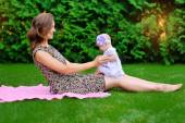 Beautiful Mother And Baby outdoors. Nature. Beauty Mum and her C — Stock Photo