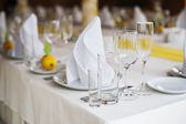 Served table with dishes and glasses — Stock Photo