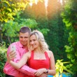 Affectionate young couple taking pictures using a smart phone at — Stock Photo #55909637