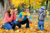 Father, mother and son happy family in autumn, yellow leaves — Stockfoto