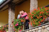 Man and woman together on balcony of their house or hotel with b — Stock Photo