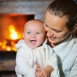 Mother And Daughter Relaxing On Sofa By Cosy Log Fire — Stock Photo #57162863