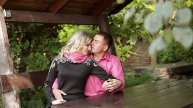 Couple in love sitting in the gazebo — Stock Video