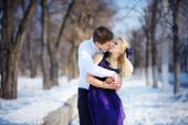 Loving couple in winter, kiss a guy and a girl — Stock Photo