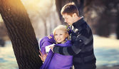 Loving couple in winter, boy care warms Woman scarf — Stock Photo