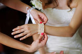 The girl wears a bracelet wedding decoration — Stock Photo