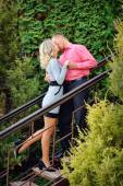 Happy young couple kissing outdoor in the park  — Stock Photo