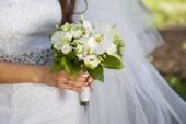 Closeup of bride hands holding beautiful wedding bouquet  — Stock Photo