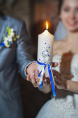 Candle bride and groom holding hands — Stock Photo