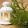 Snowy blue lantern and Christmas balls on the background of fir — Stock Photo #58805839