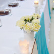 Festive table setting with roses in bright colors and vintage cr — Stock Photo #59169683