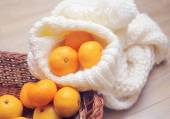 Christmas tangerines and Christmas toys on knitted scarf close-u — Stock Photo
