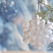 Christmas decorations - toys white snowflakes on silver material — Foto Stock #59485163