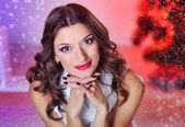 Christmas portrait of a beautiful woman in studio — Stock Photo