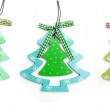 Three wooden toy Christmas tree on a white background — Stock Photo #59845777