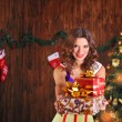Beautiful woman near the Christmas tree — Foto Stock #59915929