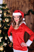 Young miss santa blowing snow  — Stock Photo