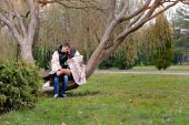 Lovers women and men walk in the park covered with a blanket — Stock Photo