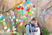 Man and woman kiss on Valentine's Day, the tree is decorated wit — Stock Photo