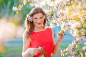 Blissful woman enjoying freedom and life in park on spring — Stock Photo