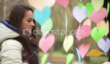Man hangs colored hearts on Valentine's Day — Stock Video