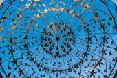 Forged metal pattern on the blue background — Stock Photo