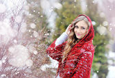 Woman with a red shawl in winter — Stock Photo