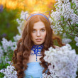 Beautiful girl in sunset in the spring park Lilac — Stock Photo #63610199