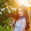 Beautiful girl in sunset in the spring park — Stock Photo #63610205