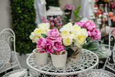 Flowers in a basket on the table — Stock Photo