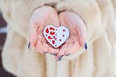 Heart in the hands of a girl — Stock Photo