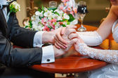 Hands of the bride and groom — Stock Photo