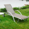 Chaise lounge on the banks of the river — Stock Photo #64711911