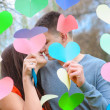 Couple in love kissing in the decoration of hearts, on the feast — Stock Photo #64712011
