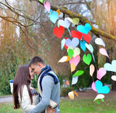 Young woman and man in the decoration of the heart, on the feast — Stock Photo