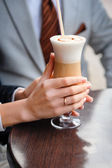 Bride drinking a latte with a heart — Stock Photo